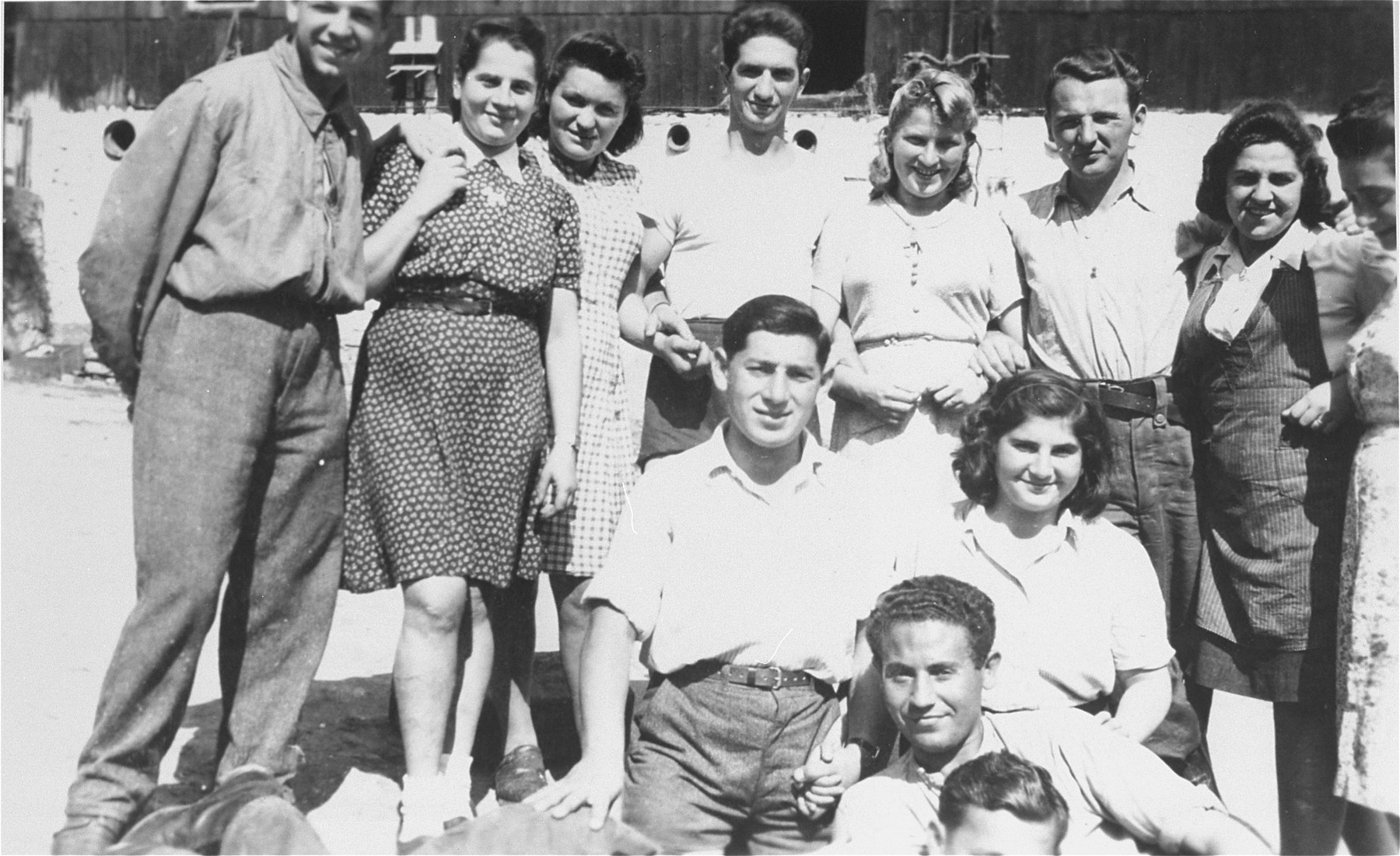 Group portrait of members of Kibbutz Buchenwald.    Those pictured include Motek Nussenbaum, Karla, Shlomo Shiff, Izik Neumann, Raiza and Sylvia.