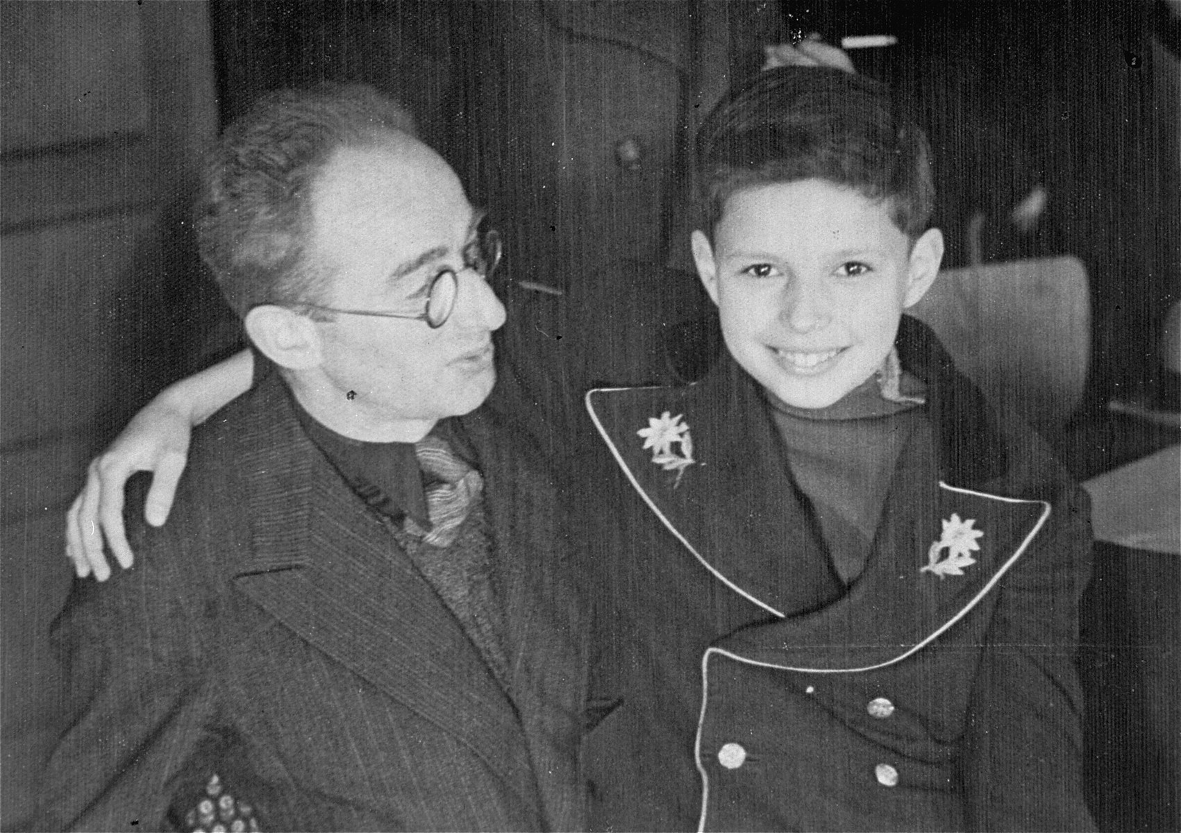 Child survivor, Luigi Ferri, poses with the Austrian Jewish physician who looked after him during their internment in Auschwitz.  The photograph is inscribed to the donor, Frieda Fish Greenspan, a Polish-Jewish survivor who befriended Luigi after the war in Krakow.