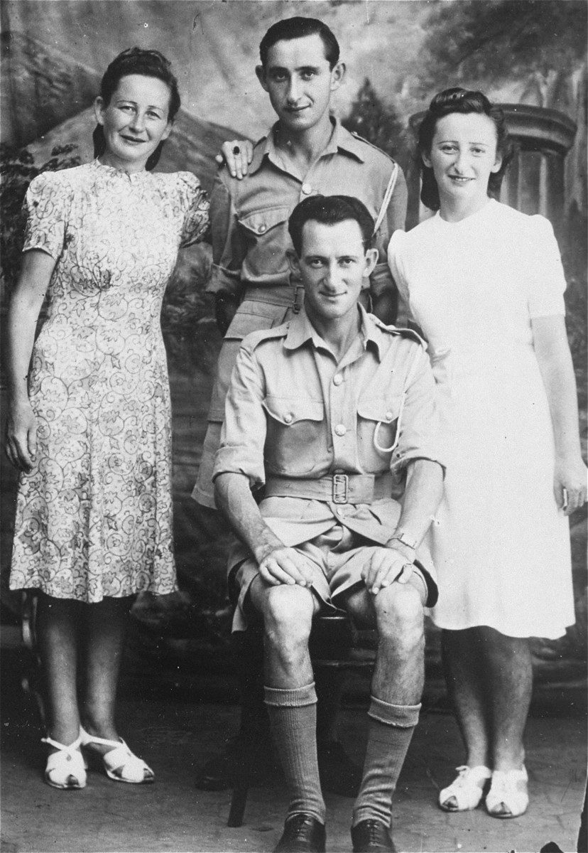 Group portrait of members of the Makowski family from Danzig during their internment on the island of Mauritius.  Pictured on the left are: Hersh and Fela Makowski; at the right are Israel Makowski and Genia (Makowski) Less.