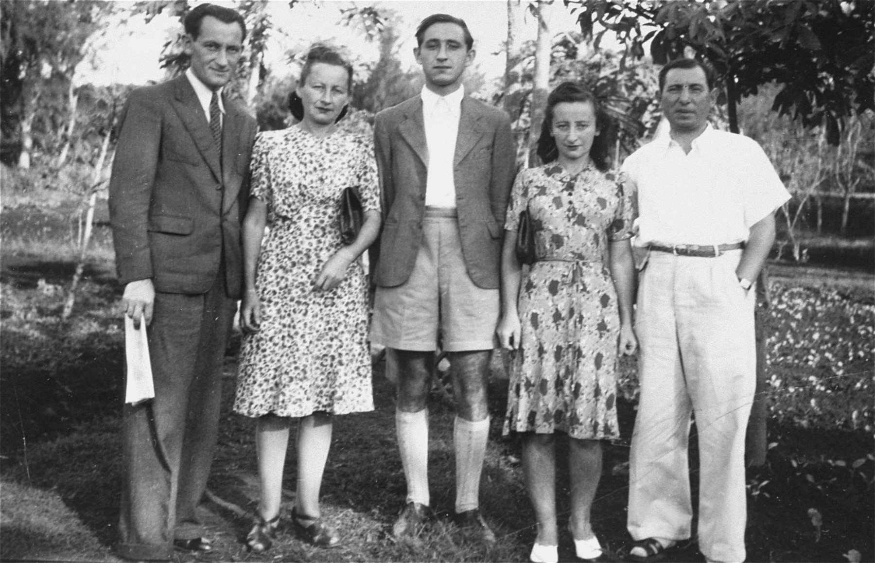 Group portrait of members of the Makowski family from Danzig during their internment on the island of Mauritius.  Pictured from left to right are: Israel Makowski, Fela and Hersh Makowski, Genia (Makowski) Less, and her husband, Beno Less.