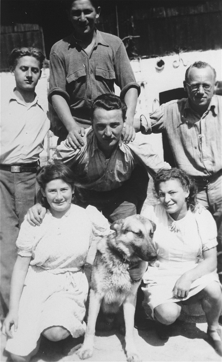 Group portrait of members of Kibbutz Buchenwald.    Among those pictured are Blumka, Aliza and Yerucham Ehrlichman.