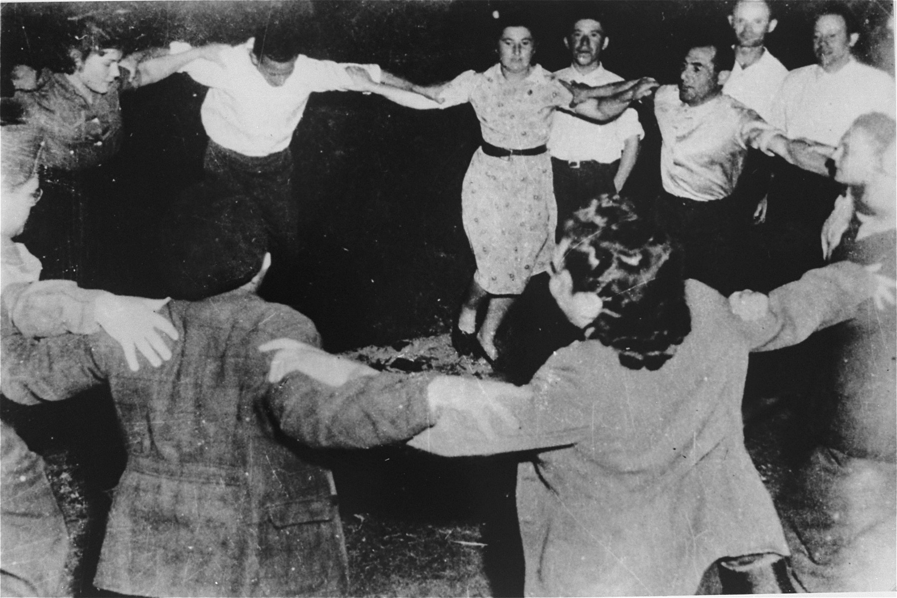 Members of the Kibbutz Buchenwald hachshara (Zionist collective) dance the hora.