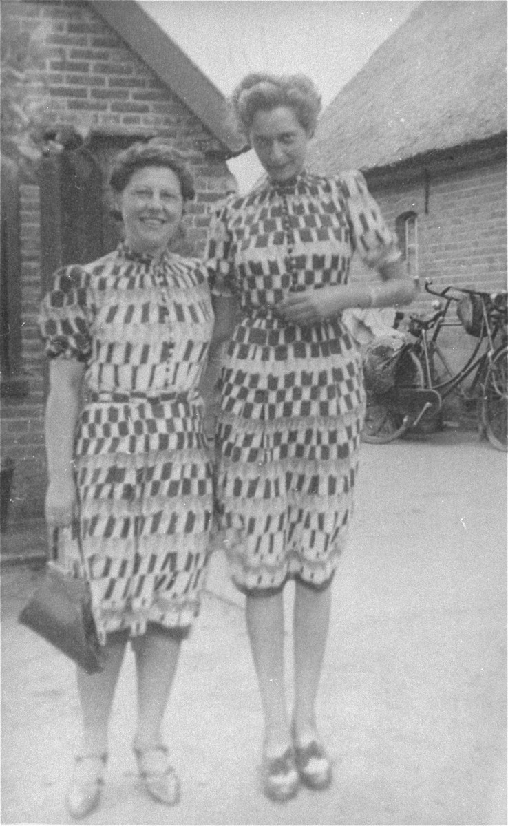 Flory van Beek (right) poses with an American relief worker from the Joint Distribution Committee.  They wear matching dresses provided by the JDC.  Flory van Beek survived the war in hiding in Amersfoort.