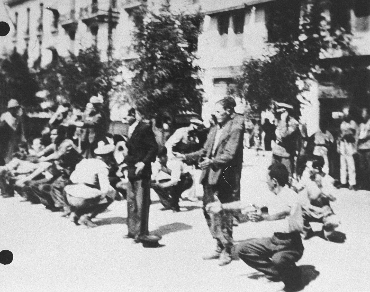 German soldiers force Jews assembled on Eleftheria (Freedom) Square to perform calisthenics.