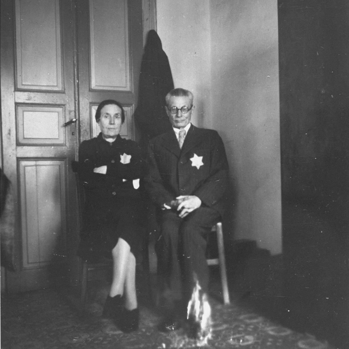 A Jewish couple wearing the yellow star poses in their apartment in Salonika.  Pictured are Rachel and Joseph Chasid, the parents of Margo (Chasid) Melech.