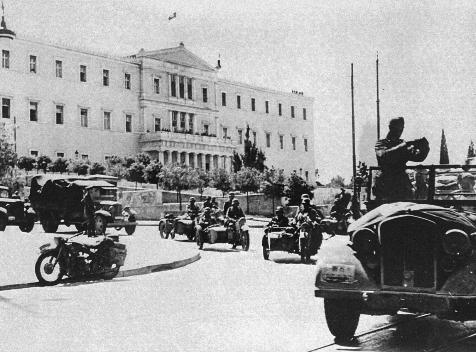 German troops drive in front of a government building in Athens during the occupation of the city.