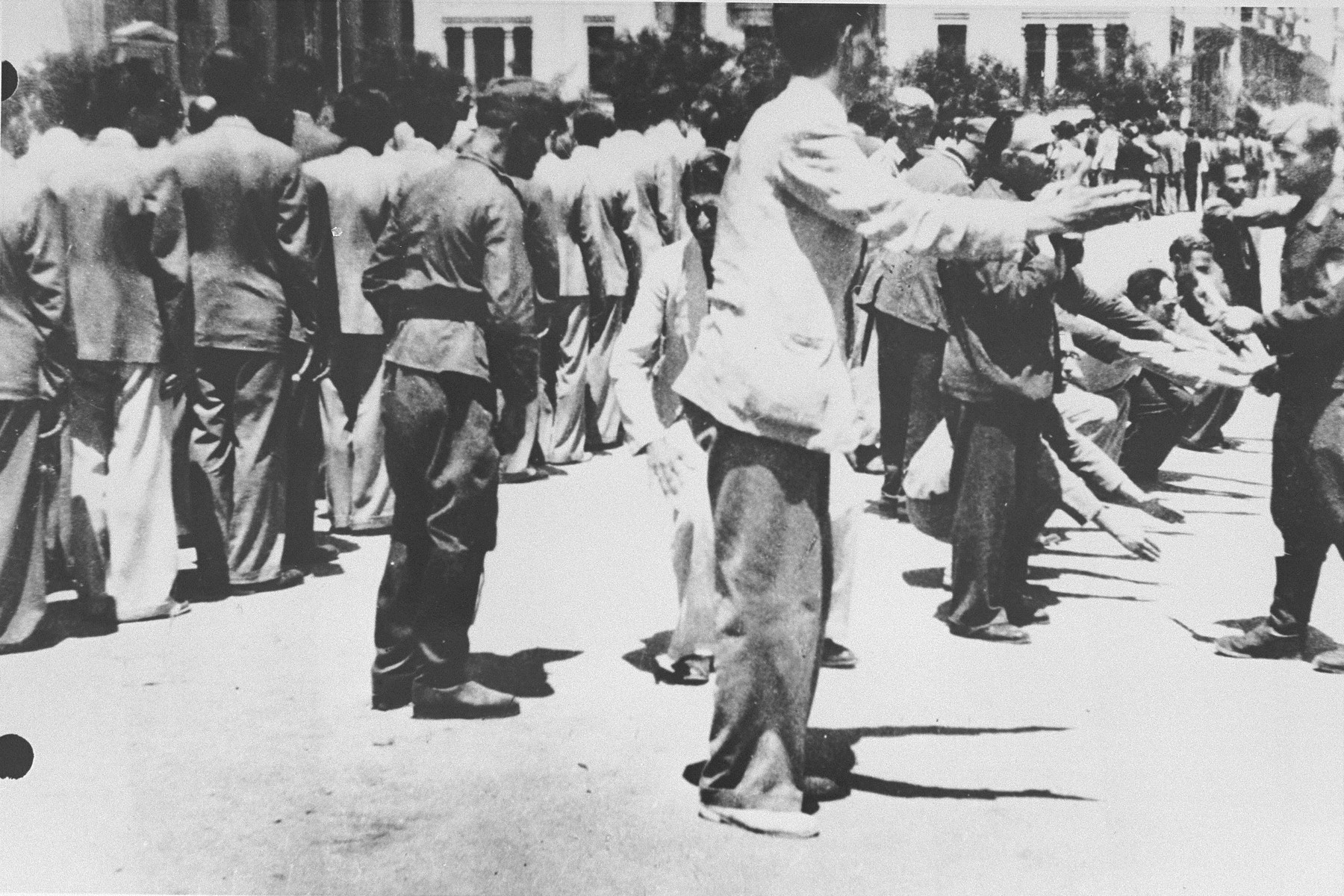 German soldiers force a group of Jews to perform calisthenics on Eleftheria (Freedom) Square in Salonika.