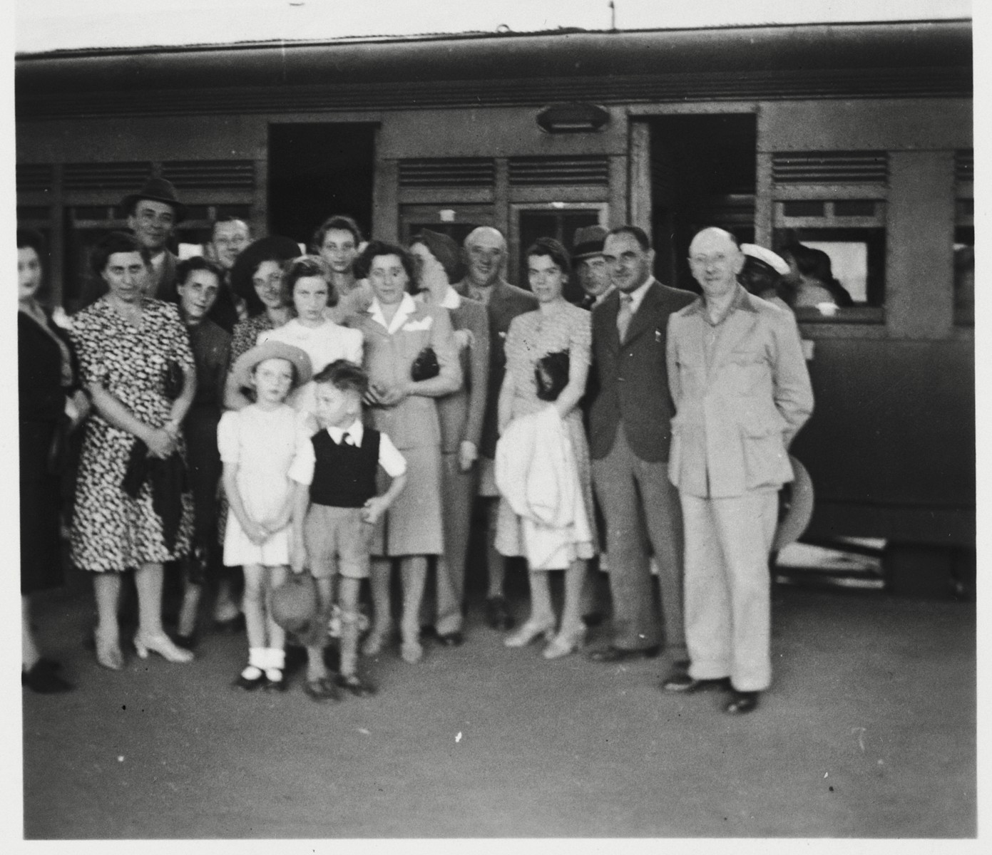 The Berg family is gathered on the platform at a train station in Kenya before their departure for the U.S.   Pictured are Eliahu Fried, Sarah (Meyer) Berg, Sabina Lustman, Mrs. Bruckman, Erna (Meyer) Baum, Gisela Berg, Inga Berg, Klara Berg, Else Berg, Ernest Berg, Rosel (Marx) Berg, Mr. Bruckman, Adolf Baum and Josef Berg.