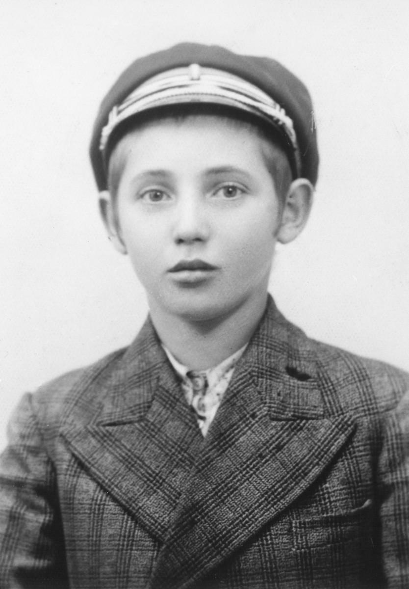 Portrait of Zoltan Farkas in a cap and jacket.