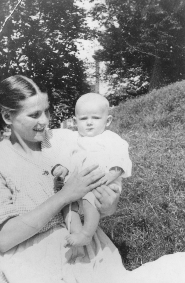 Leah Rygier holds her newborn baby in an orphanage where they were hiding.