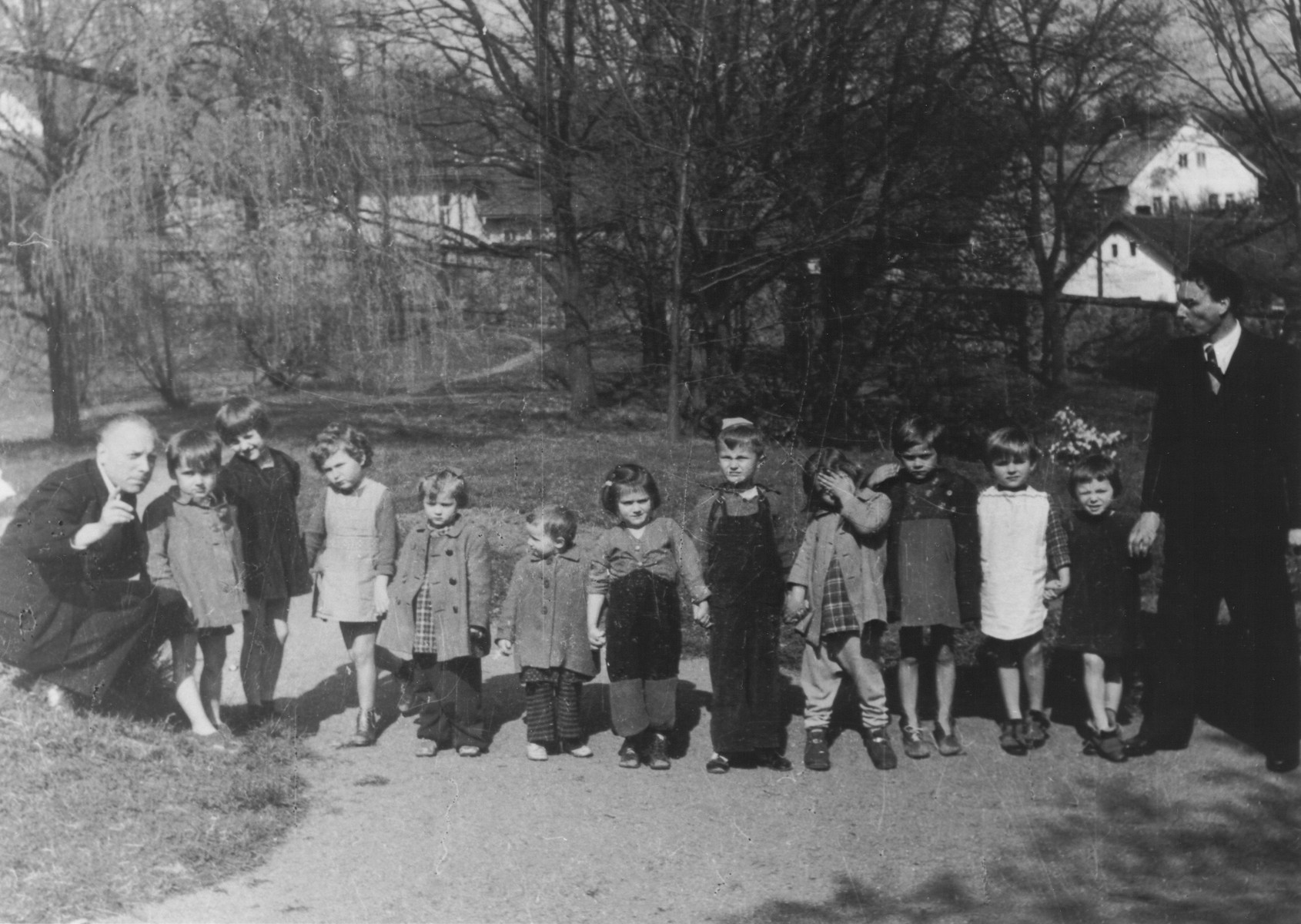 """Premysl Pitter (left) poses with a group of young DP children living in one of """"The Castles"""" children's homes he established along with Olga Fierzova."""