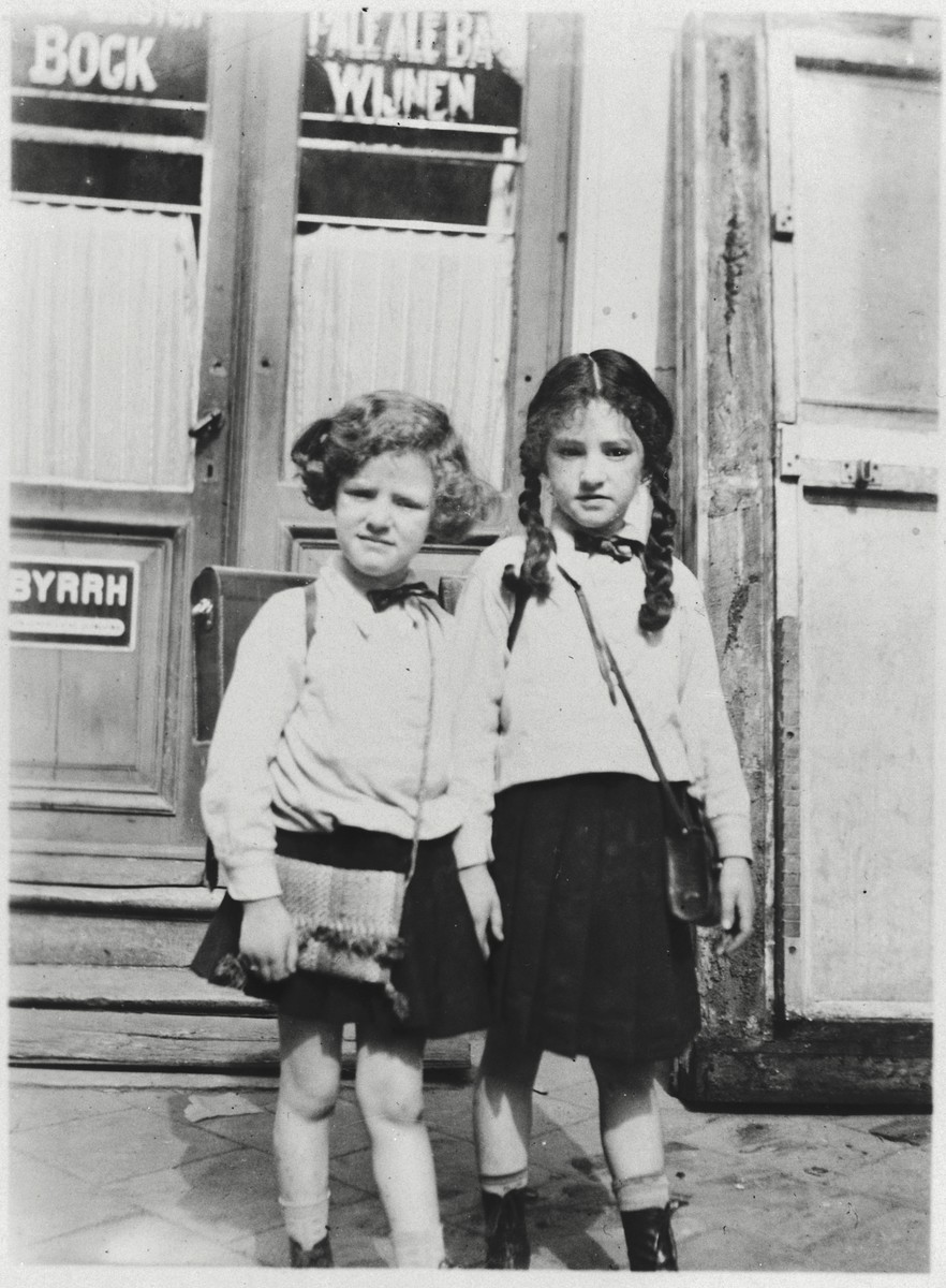 Two sisters prepare to leave for their first day of school in Belgium where their family had fled shortly after the Nazi seizure of power.  From left to right are Shulamit and Gitta Posner.