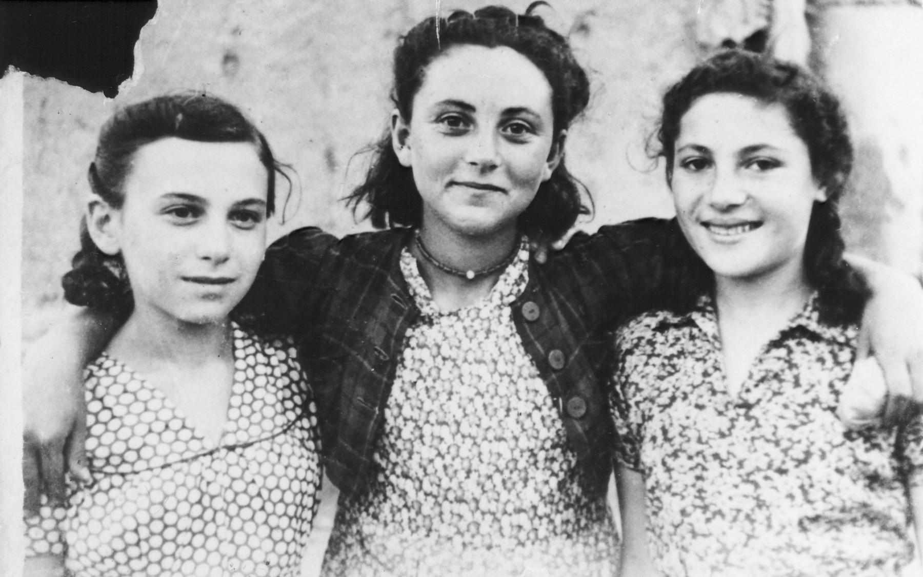 Portrait of three Jewish refugees in Uzbekistan.  Mira Stillman is pictured on the far left.