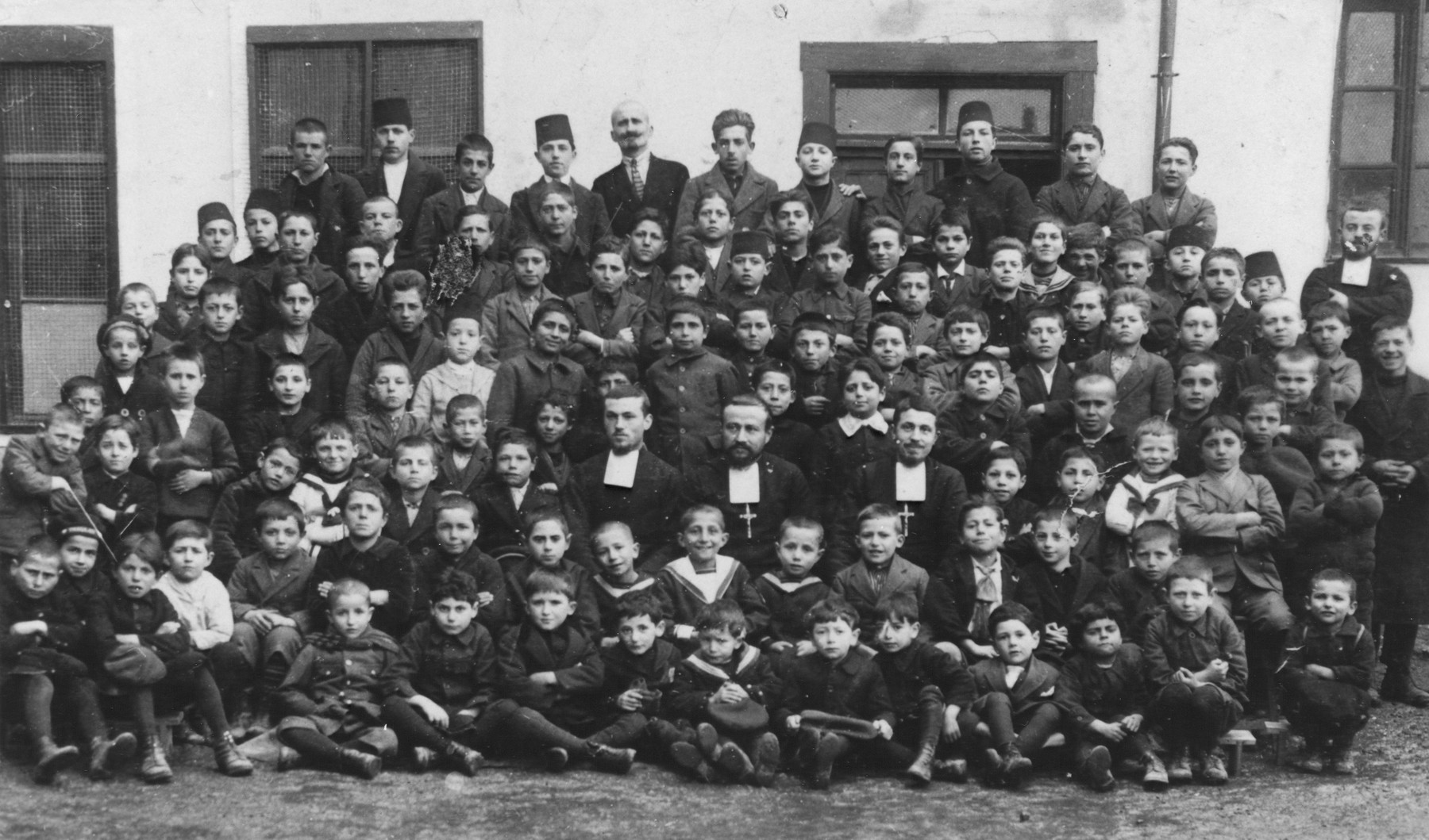 Group portrait of a school in Bitola with Greek Orthodox priests.