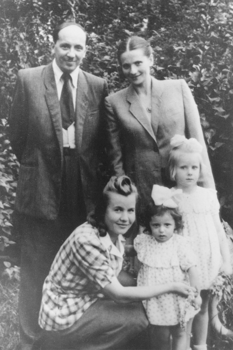 The Rygier (Szymeczko) family poses together after the war.  Pictured are Josef, Leah, Wanda, Ela and a nanny.