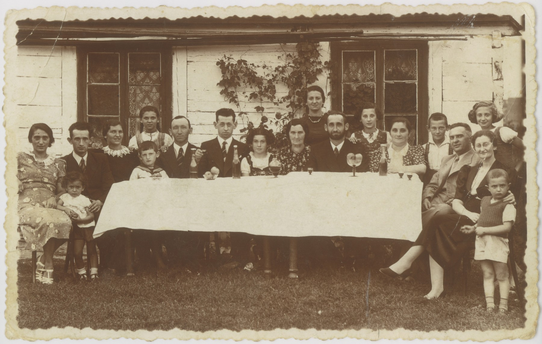 The Rybstein and Zylberszac families gather for a large family reunion.  Gucia Zylberszac is pictured standing on the far left.  Of all those pictured, only she survived the Holocaust.