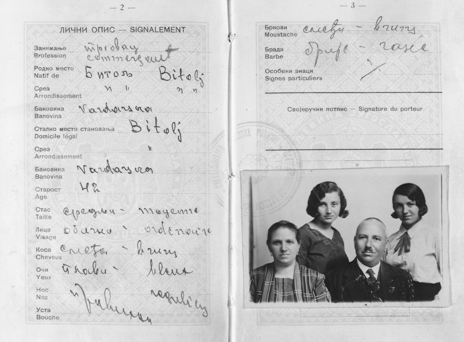 Passport with an attached photo of a Jewish family in Bitola, Macedonia.