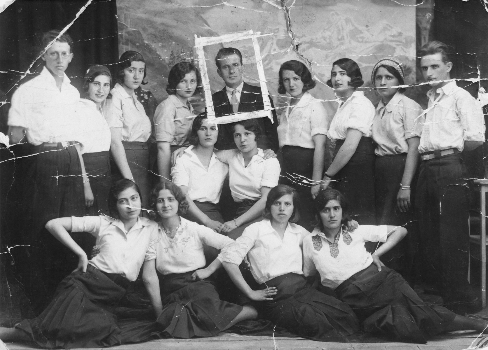 Group of Jewish young women and men wearing white shirts in Macedonia.
