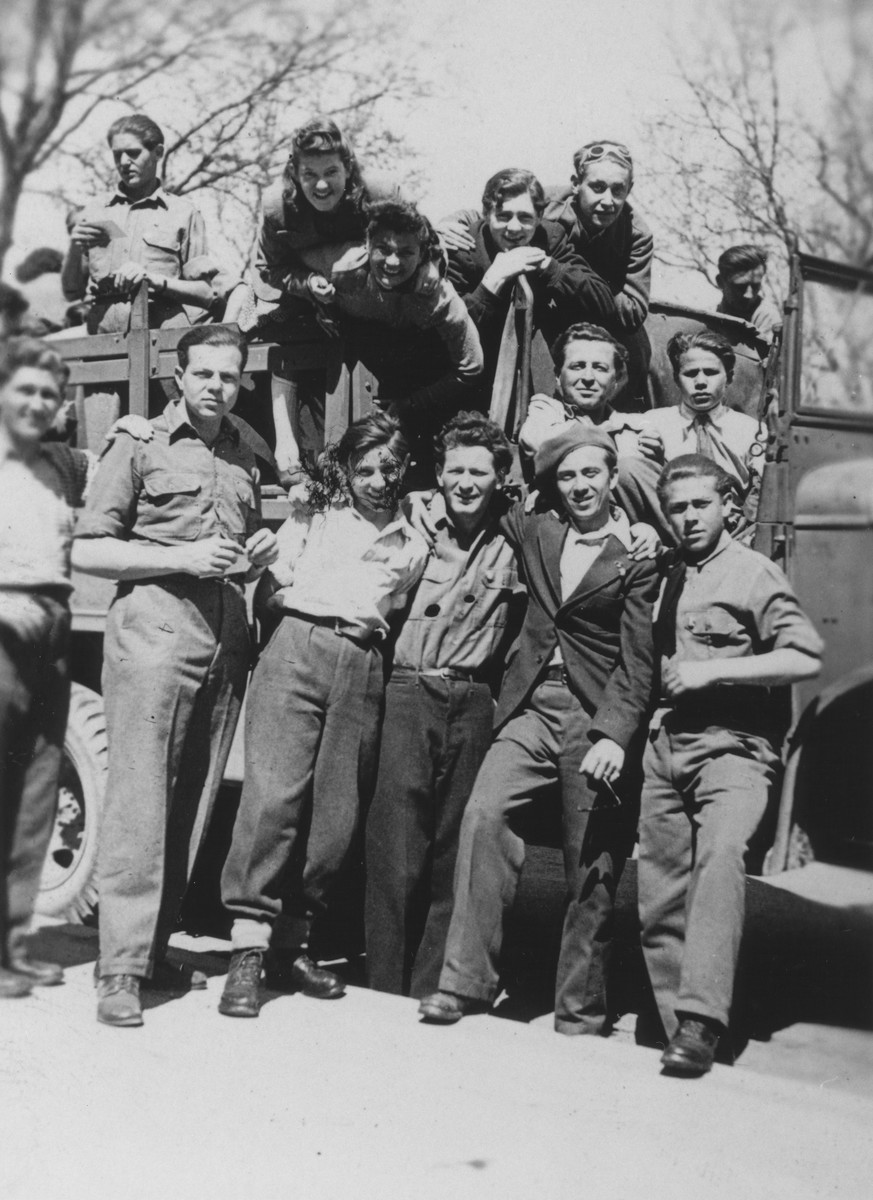 A group of youth board an open truck at Prien am Chiemsee that will take them on an excursion to see a movie in Munich.  Erwin Farkas is pictured on the top row, second from the right.  Genia Edlerman (later Jean Sugar) is in the top row, second from the left.  Iwan Kisz (later Irving Klein) is in front on the far left.  Ber Makowski is third from left (front).  Next to him is David. Sofia Myskiw is standing third from the left leaning over the rail.  David Yeger (from Romania) is pictured in the back row, far left.