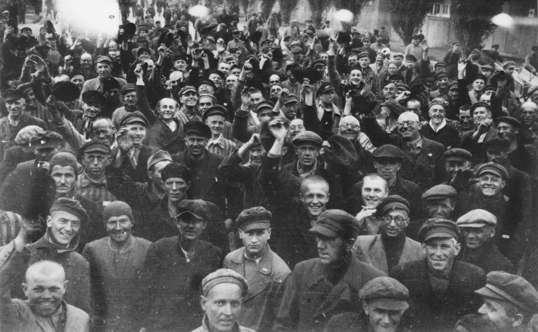 Russian, Polish and Jewish prisoners in Dachau celebrate their liberation by American forces.