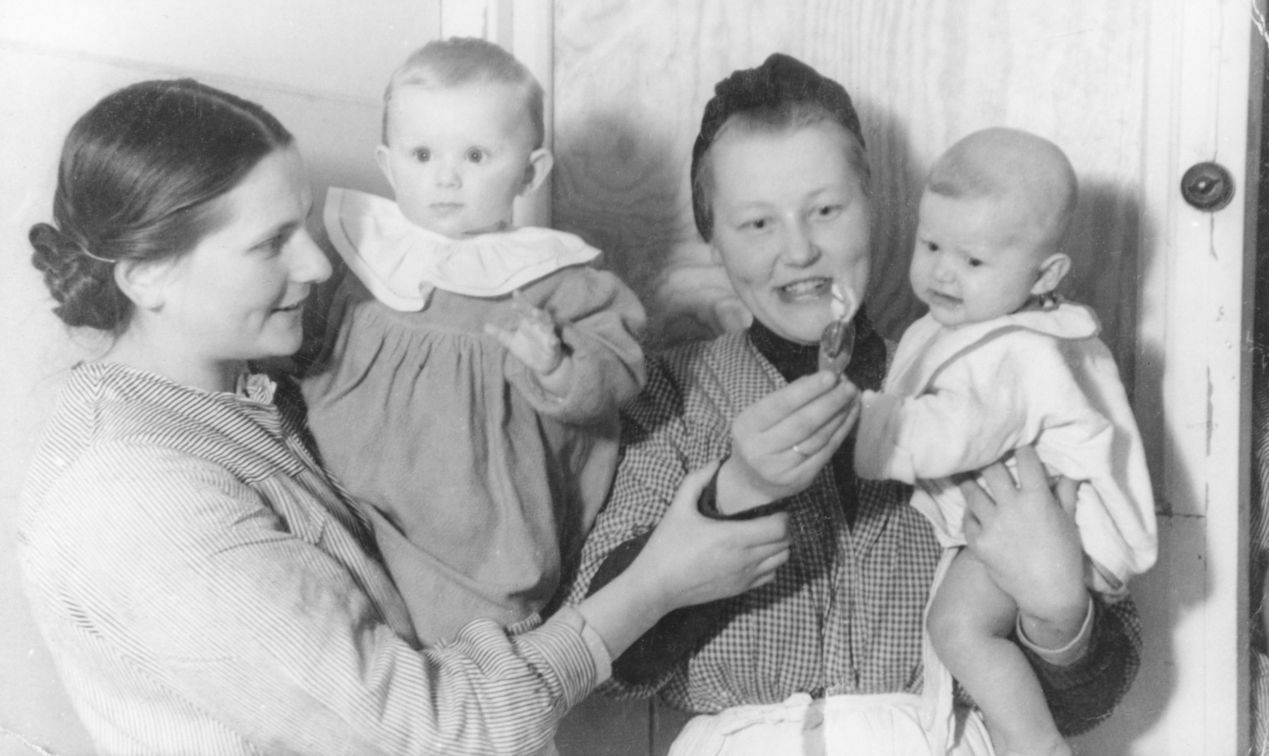 Leah Rygier holds her daughter Wanda in an orphanage where they were hiding.  A Polish woman holding another baby is standing next to her.