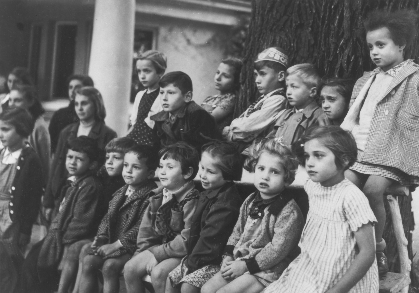 "Young DP children watch an outdoor program at one of ""The Castles"" children's homes established by Premysl Pitter and Olga Fierzova."