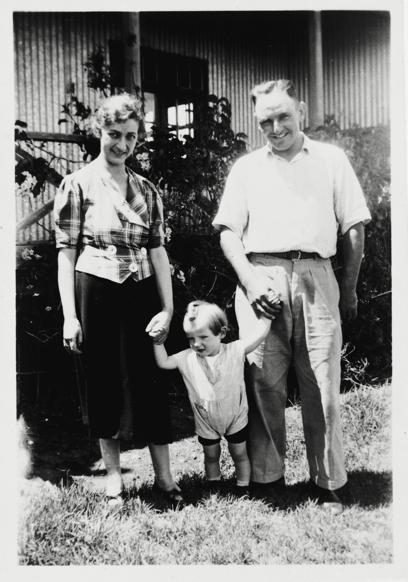 A Jewish refugee family poses outside their new home in Kenya shortly after their arrival from Holland.  Pictured are Adolf and Erna (Meyer) Baum with their daughter Hannah.