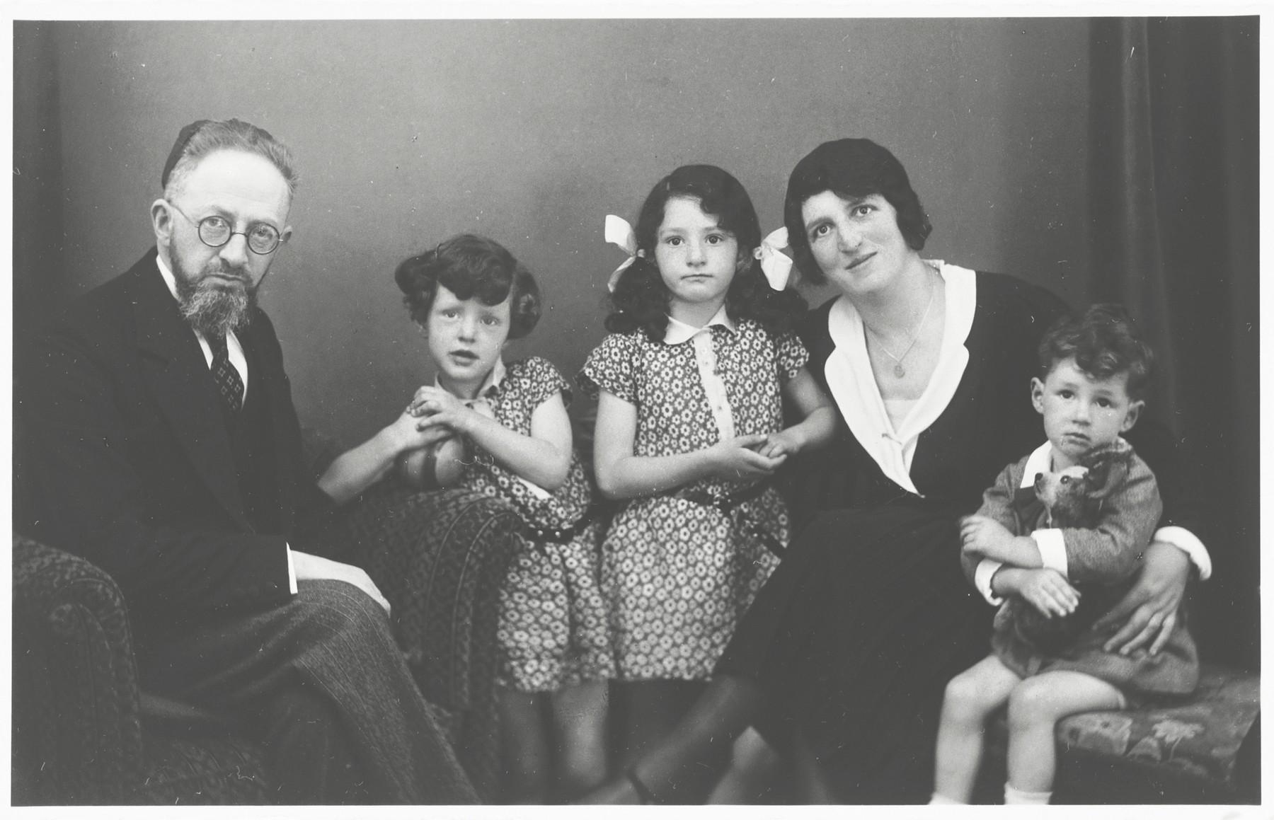 Portrait of the family of Rabbi Baruch Posner.  Pictured are Rabbi Posner, Shulamit, Gitta, Rosie and Avraham.
