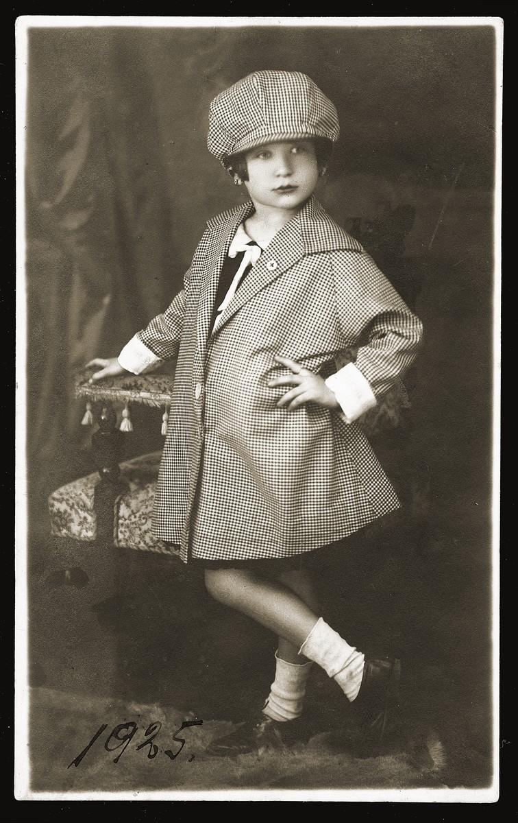 "Studio portrait of Gabriela (Ela) Konfino, taken by her father at his photo studio, ""Studio Gavra,"" in Belgrade."