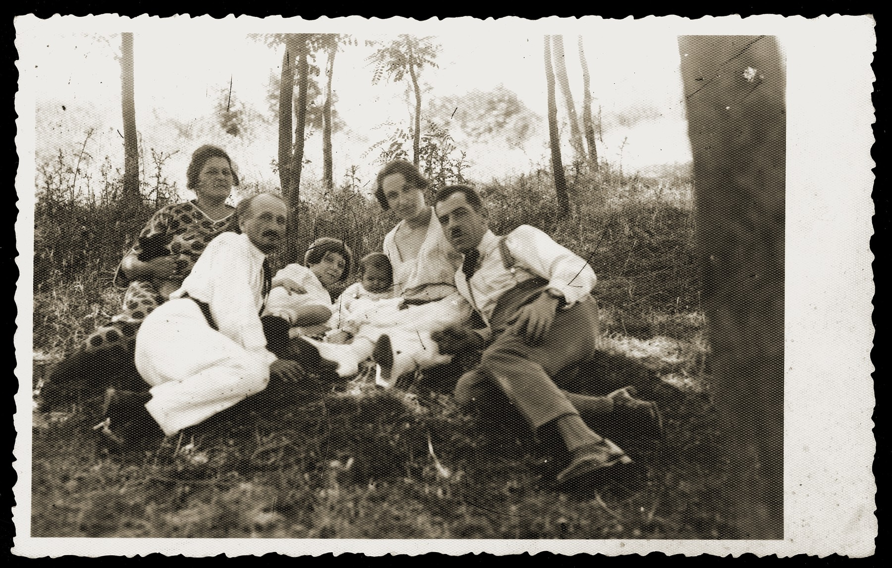 The family of Gavra Konfino on an outing in Belgrade.  From right to left are Gavra, Elizabeth, Gizella and Gabriela (Ella) Konfino and an unidentified couple.
