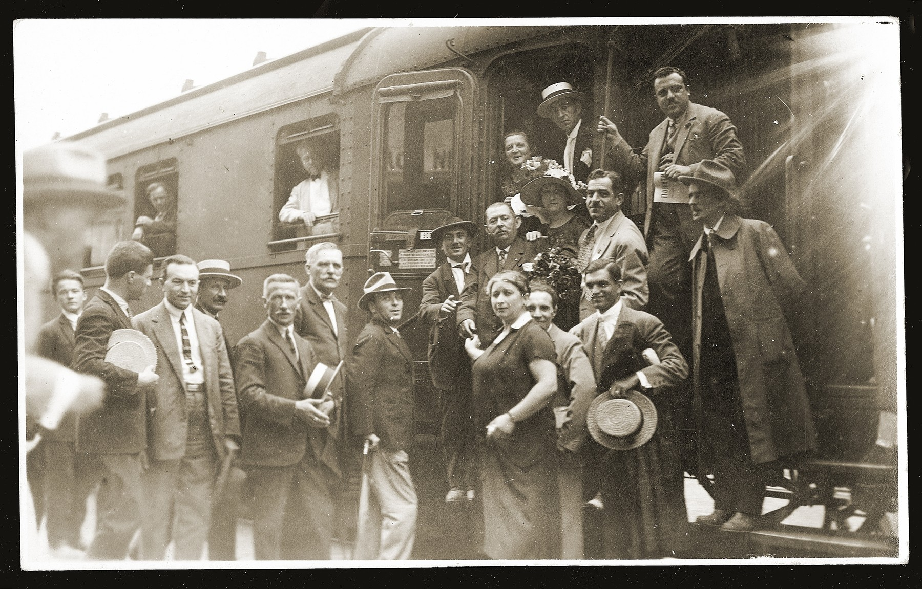 Members of the Serbian photographers' union pose at the Belgrade train station before their departure for a photographers' convention in Vienna.    Gavra Konfino, the chairman of the photographers'  union is standing in the second row, second from right.