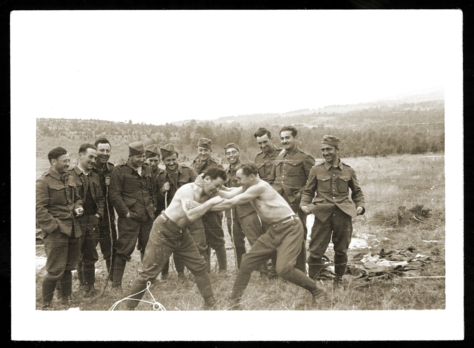 Two Jewish soldiers in the Slovak army wrestle while others look on.  The Jewish units were assigned to manual labor and not permitted to carry weapons.