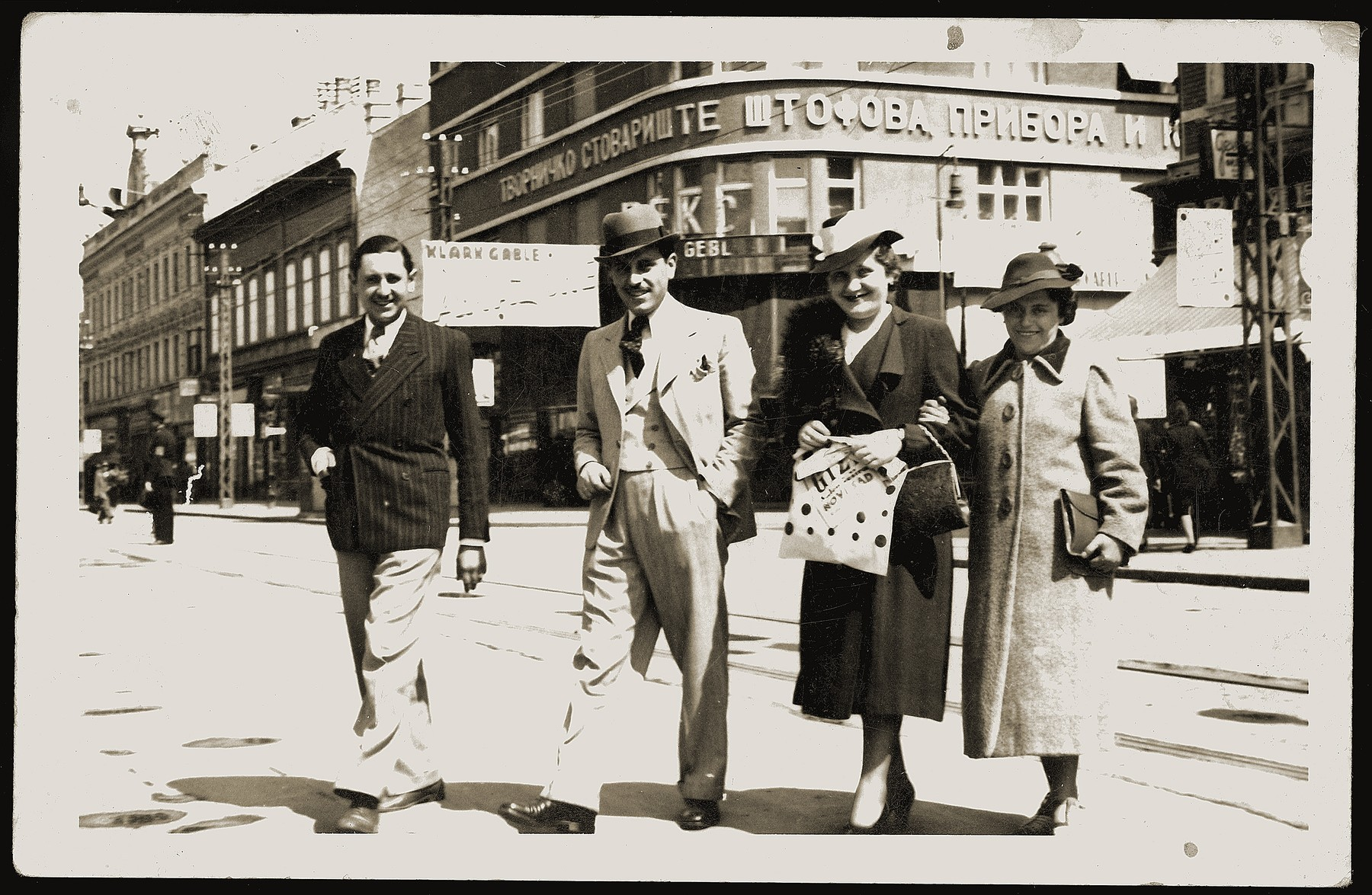 Members of the Mandil family pose on a street in Novi Sad, Yugoslavia.  Pictured are Mosa (Moshe) and Gabriela Mandil (center) with his Mosa's sister Streja (right) and a friend.