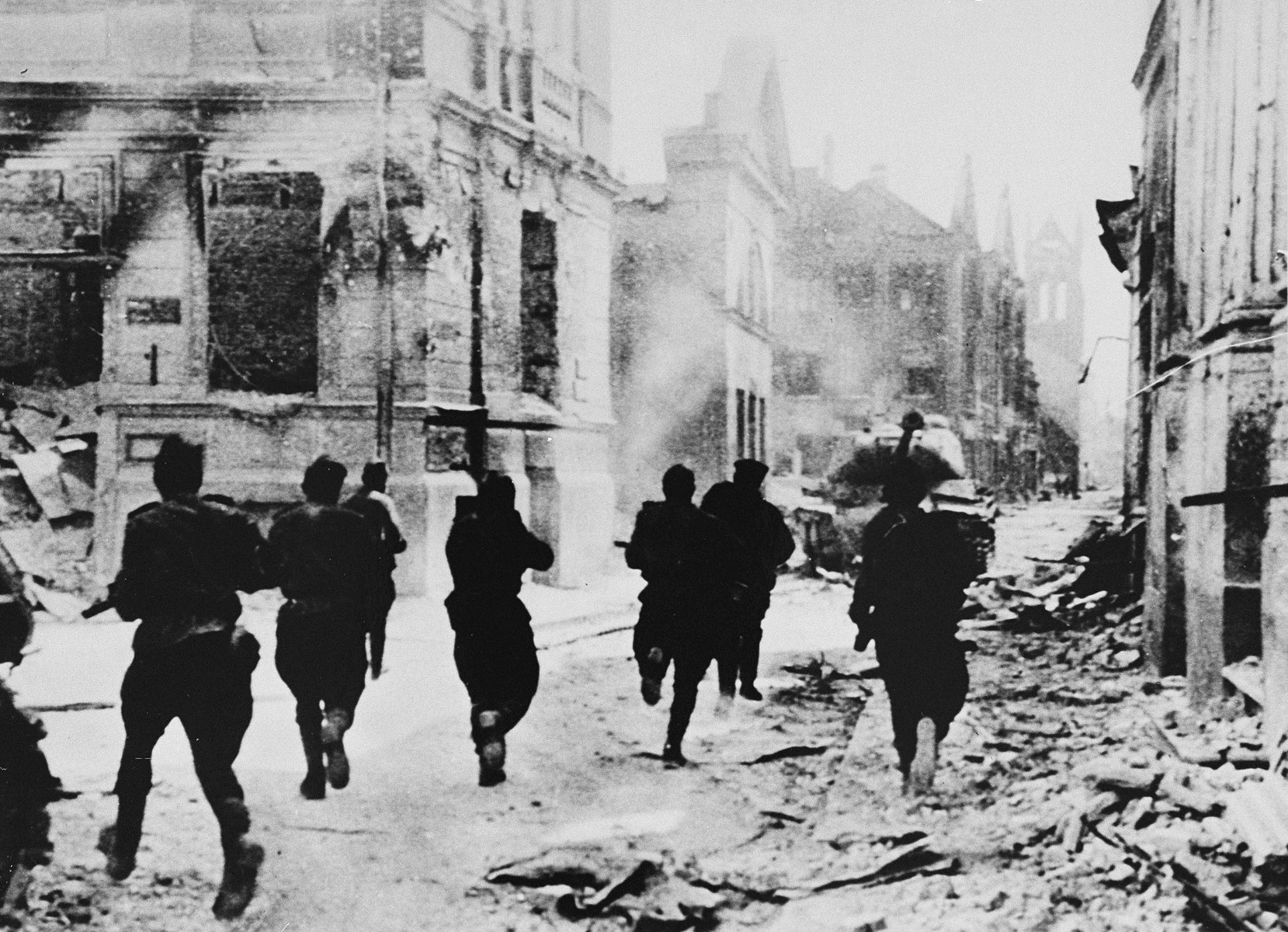 Armed Soviet troops run through the streets of Jelgava during the liberation of Latvia.