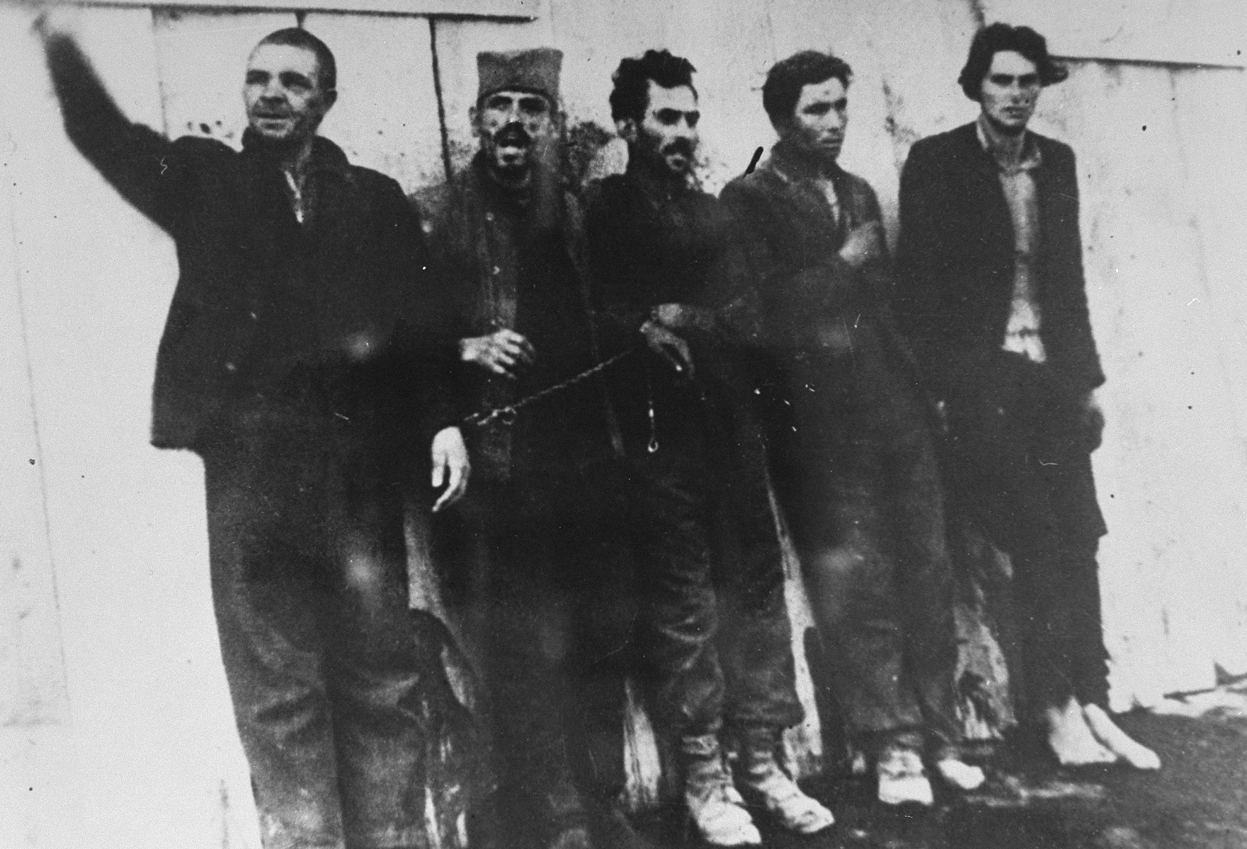 Five Serbian partisans just prior to their execution by a German army firing squad.  According to the Muzej Revolucije Narodnosti Jugoslavije, the men being executed are members of the regional committee of the Communist Party.