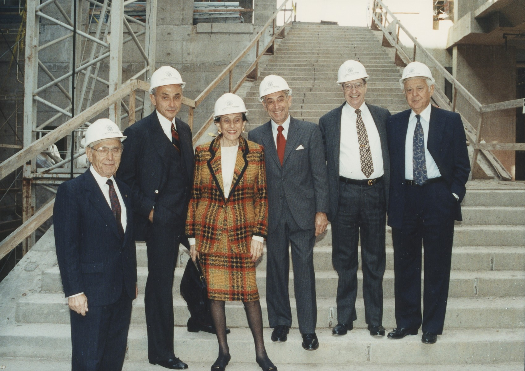 Standing before the grand staircase in the unfinished Hall of Witness are, from left, National Campaign Chairman Miles Lerman; Leslie Wexner; his mother, Bella Wexner; Council Chairman Harvey M. Meyerhoff; Albert Ratner; and Albert (Sonny) Abramson. The Wexner Family donated $5 million to underwrite the Learning Center on September 20, 1991.