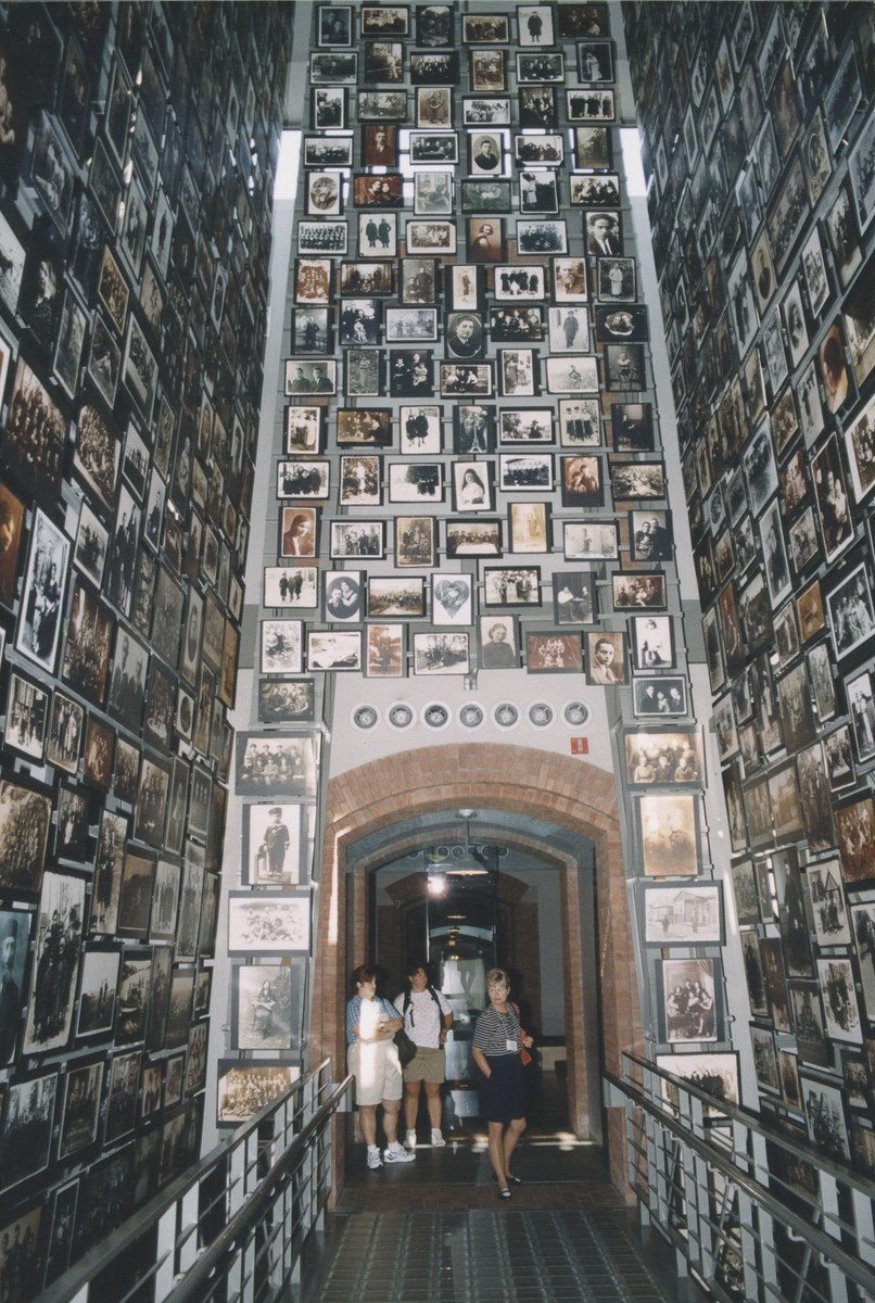 Visitors in the Tower of Faces (the Yaffa Eliach Shtetl Collection), U.S. Holocaust Memorial Museum.