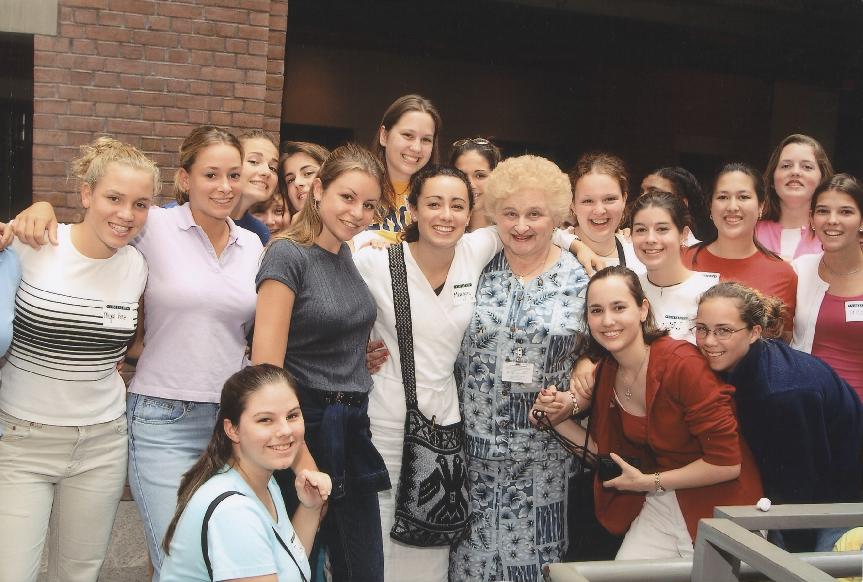 Nesse Godin, a survivor-volunteer at the U.S. Holocaust Memorial Museum, poses with a group of students from the Georgetown Visitation Day School.