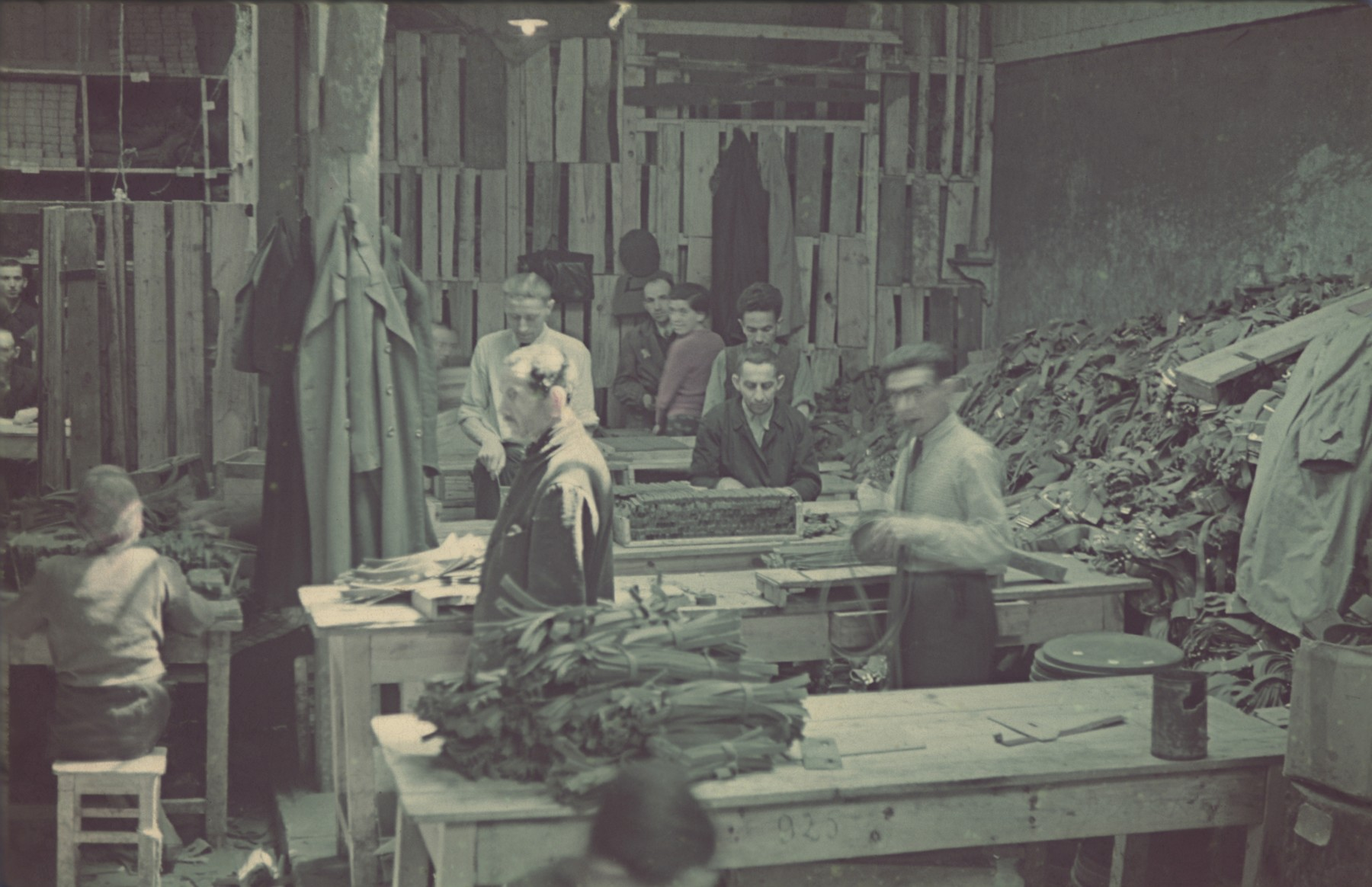 "Jews cut leather strips in the saddle-making workshop in the Lodz ghetto.  ""Getto-Litzmannstadt, Sattlerei"" (saddlery), #183."