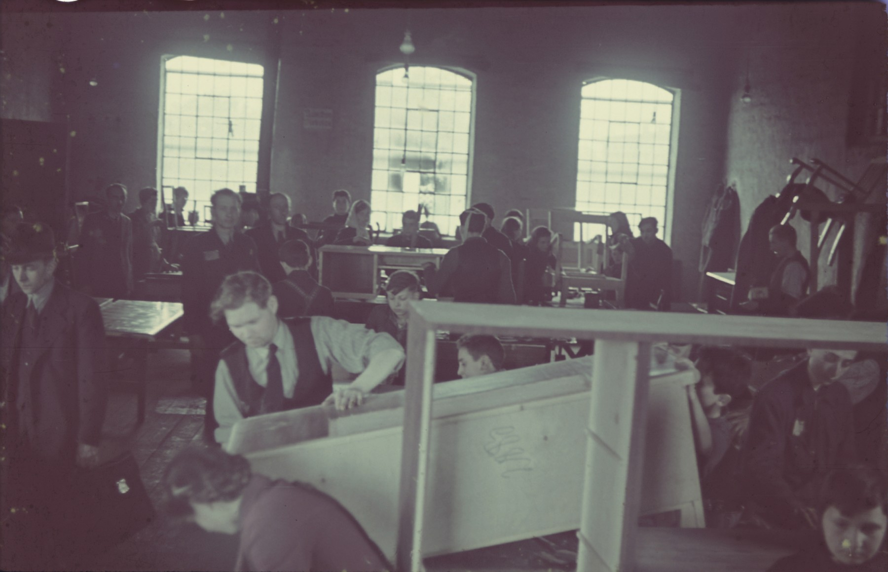 "Carpenters work in the Lodz ghetto furniture factory.  Original German caption: ""Litzmannstadt Getto: Moebelfabrik"" (furniture factory), #8."