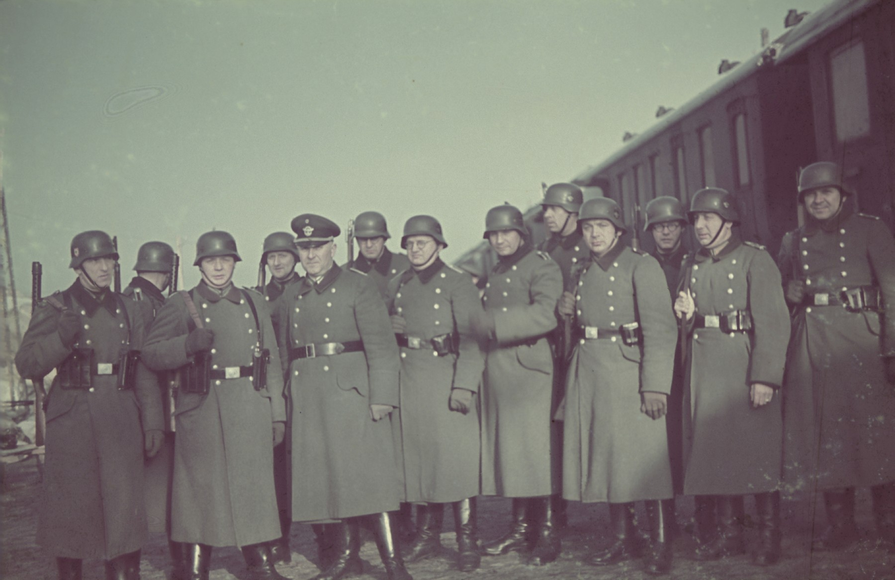"A unit of deportation police (Evakuierungspolizei) poses in the Lodz ghetto in the spring of 1942.  Original German caption: ""Evakueringspolizei"" (deportation police), spring 1942, #128 (number somewhat blurred and hard to read.)"