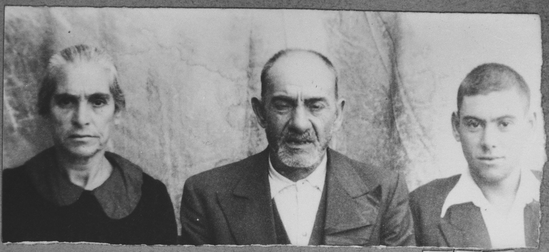 Portrait of Yakov Mishulam, his wife, Reina, and his son, Lazar.  Yakov was a laborer and Lazar, a student.  They lived at Orizarska 1 in Bitola.