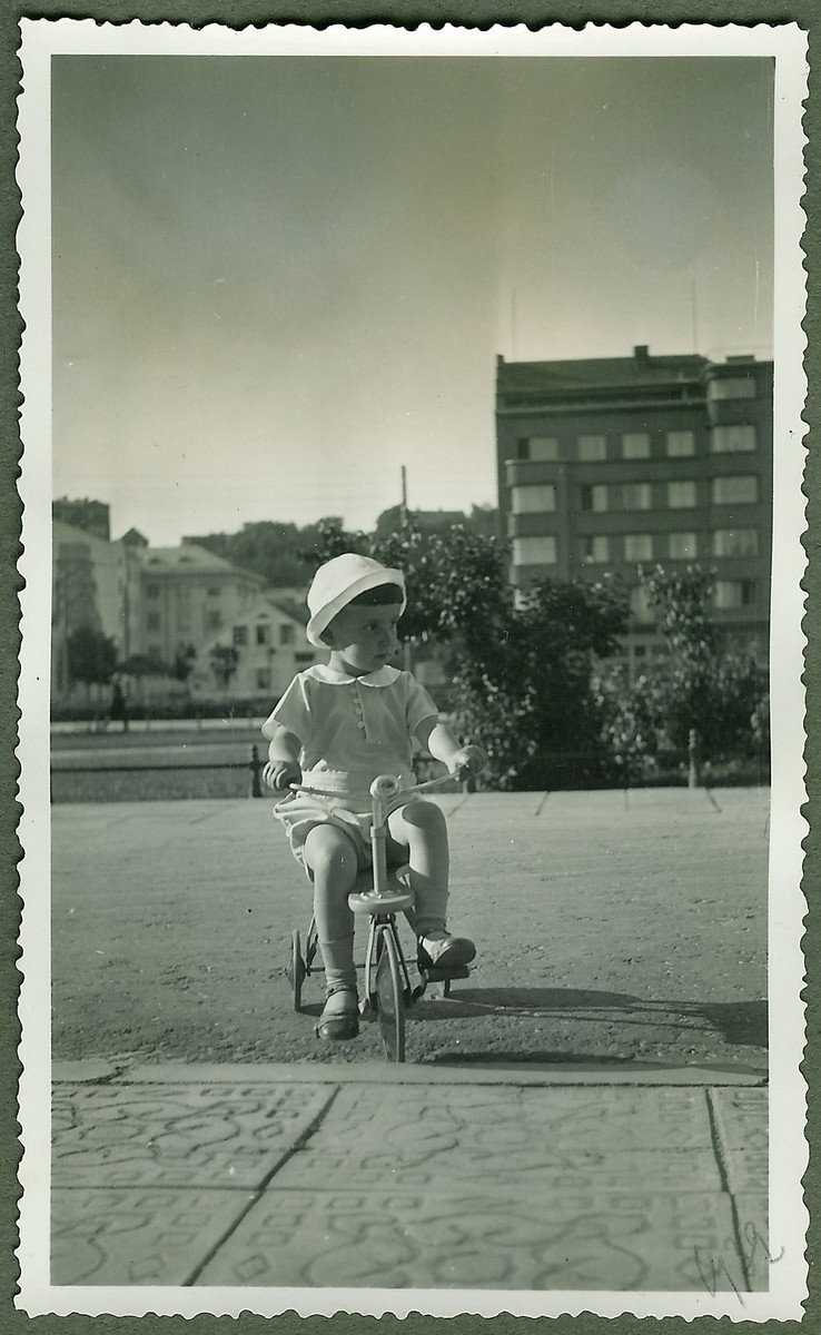 Dmitri Kopelman rides his tricycle near his home on Vienybes Square in Kaunas.