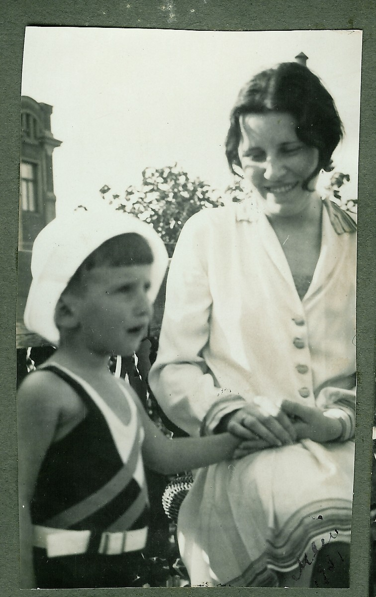 A mother and her young son pose on the balcony of their home in Kaunas, Lithuania.  Pictured are Eugenia and Dmitri Kopelman.