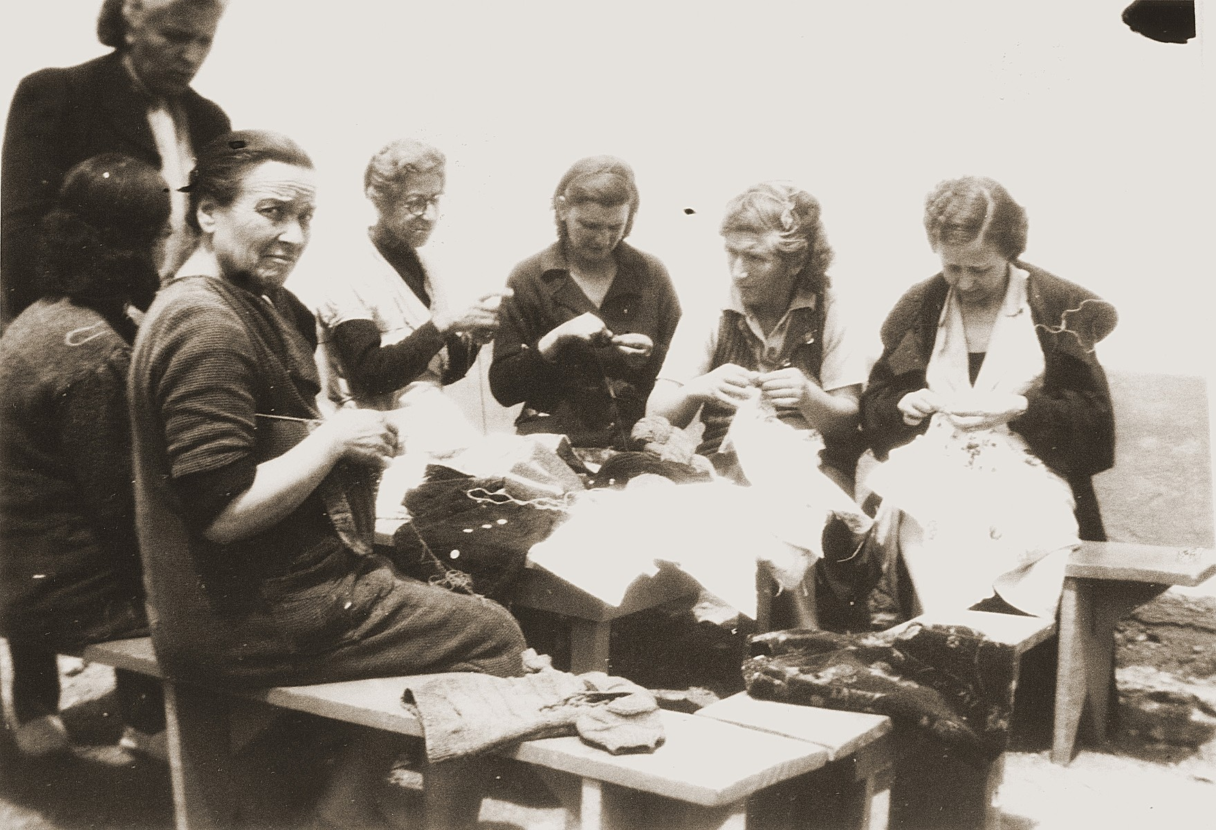 Female internees sew in a workshop organized by the Secours Suisse aux Enfants.
