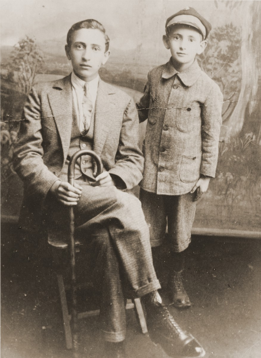 Studio portrait of two Jewish brothers in Brody, Poland.  Pictured are Samuel (left) and Henryk Lanceter.  Samuel (b. 1913) later perished in the Belzec concentration camp.