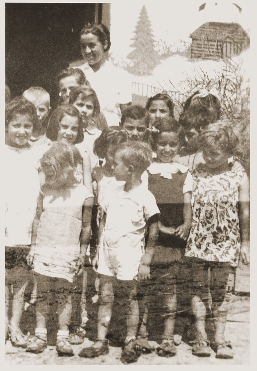 Friedel Reiter poses with a group of children in the Rivesaltes internment camp.