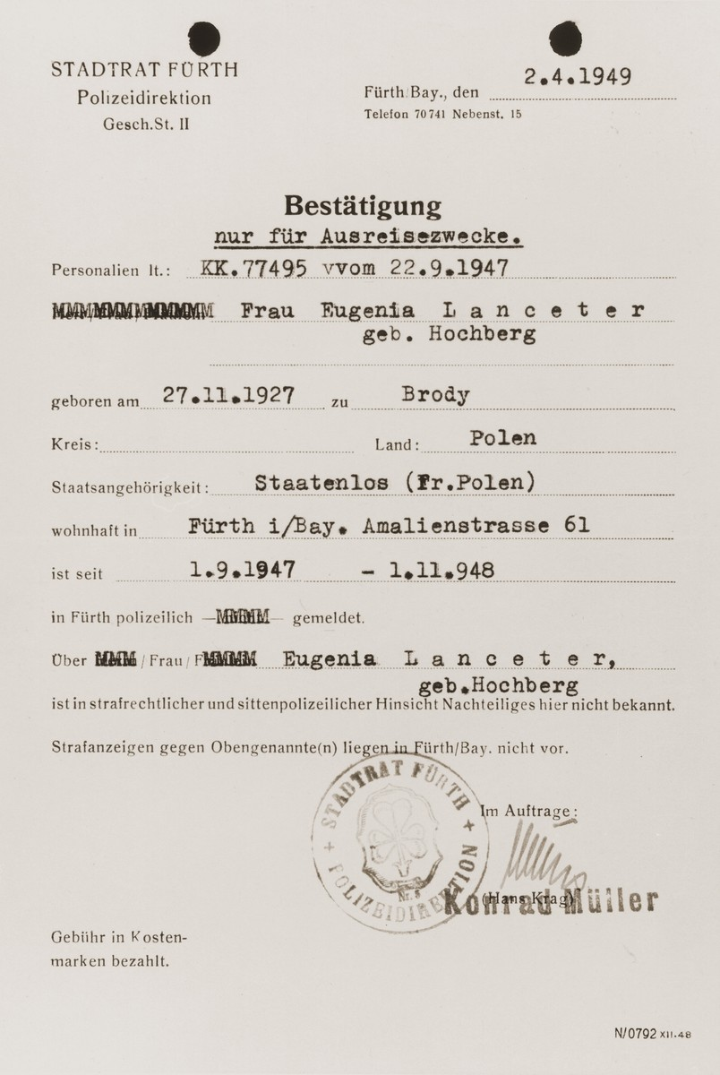 Authorization from the Fuerth city council permitting the Jewish DP, Eugenia (Hochberg) Lanceter, to leave the country.