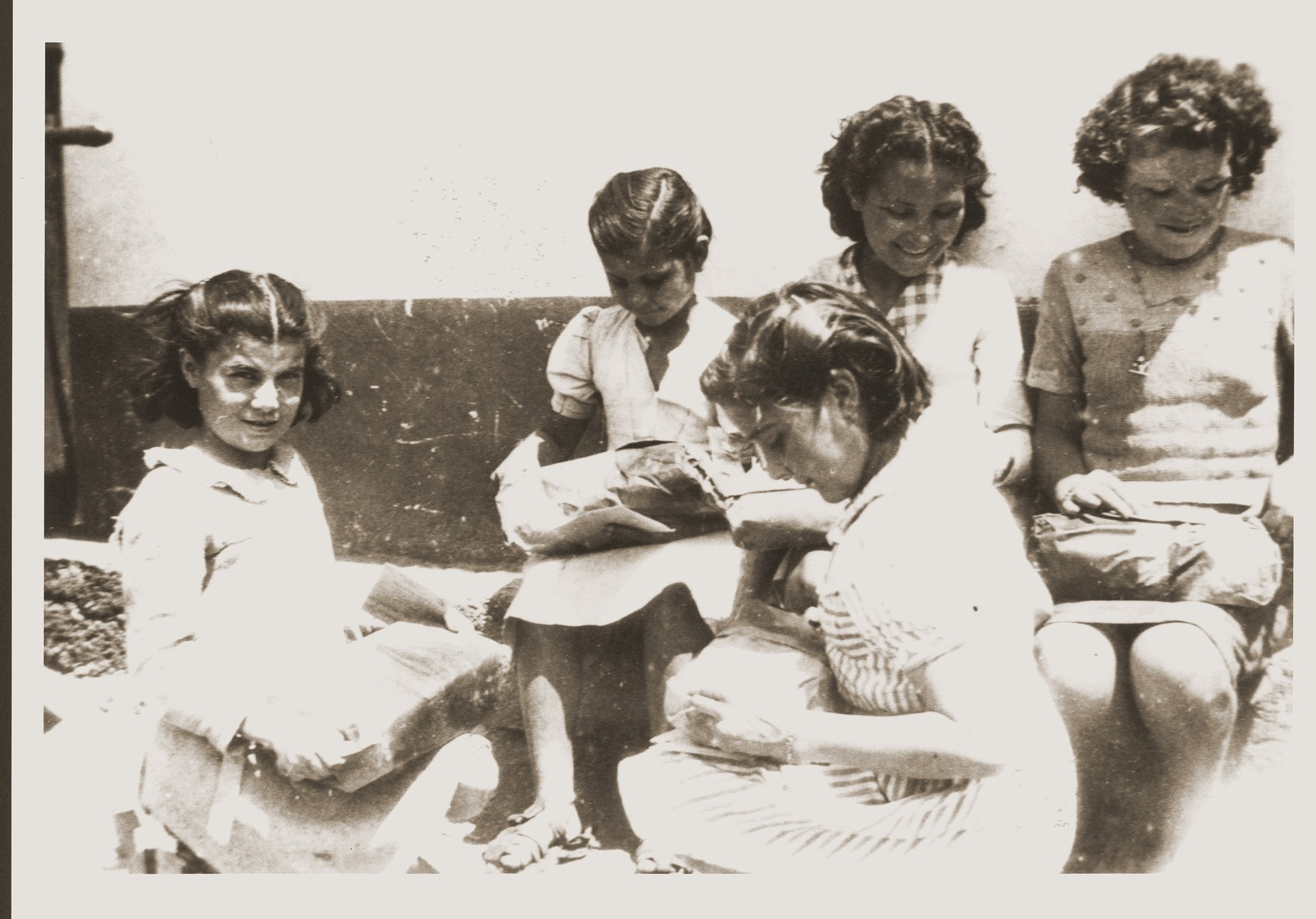 "Children open packages from their Swiss ""godparents"" in the Rivesaltes internment camp."