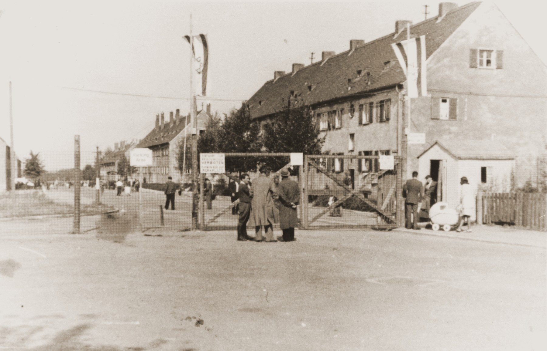 View of the entrance gates to the Finkenschlag displaced persons camp in Fuerth, Germany.  The donor, Eugenia Hochberg (b. November 27, 1928), is the daughter of Bernard and Diana Harmelin Hochberg of Brody, Poland.  She had one brother, Sigmund (b. 1922).  Her father earned his living as a grain shipper.  Eugenia attended a private non-religious Jewish school in Brody.  After the German invasion and the repartition of Poland in the fall of 1939, Brody came under Soviet occupation.  For two years the Hochbergs remained in their home, but were compelled to share their living quarters with other Jewish families.  No longer permitted to run his own business, Bernard was forced to take work as a night watchman.  In June 1941, following the German invasion of the Soviet Union, Brody fell under Nazi domination.  On November 27, 1941 Bernard was deported to a labor/concentration camp in Zborow, where he remained for five months until his wife could purchase his freedom and bring him home.  The Hochbergs relocated to the ghetto after its establishment in the winter of 1941-42.  During this period Eugenia was sent for forced labor to various sites outside the ghetto.  She also performed secretarial tasks in the offices of the Judenrat.  The family was rounded-up during the final liquidation of the Brody ghetto on May 21, 1943.  While on the deportation train to Majdanek, Eugenia's parents forced her to jump off before they reached their destination.  Eugenia was found semi-conscious by Polish peasants who stole her clothing and were about to take her to the police, when a railway worker appeared and insisted on taking her himself.  Instead of turning her in, however, he offered her temporary shelter and found clothes for her to wear.  Eugenia found her way back to Brody, where she smuggled herself into the forced labor camp.  Several weeks later she smuggled herself back out and found refuge with a Polish woman, who harbored other Jews for payment.  Eugenia narrowly escaped capture by the Gestapo during a raid of her place of refuge in February 1944.  Though she was able to find a Russian woman to take her in, Eugenia had to spend the last six weeks of the war concealed in a hole under the woman's bed.  Following her liberation in March 1944, Eugenia lived for a time in Brody and Lublin.  She married Henryk Lanceter in July 1945, and five months later left for Germany.  The couple took up residence in the Finkenschlag DP camp in Fuerth, where their daughter was born.  In the summer of 1949 the family emigrated to the United States, sailing aboard the SS General Holbrook to Boston.